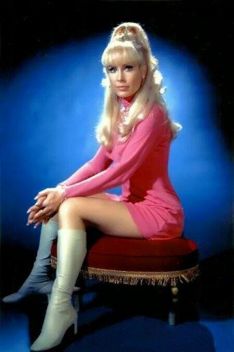 Actress Barbara Eden's amazing look on the pink dress and long boots
