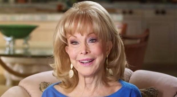 Barbara Eden on blue dress and light makeup, giving a million-dollar smile