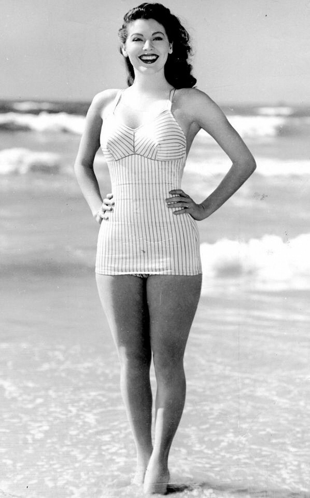 Ava Gardner on a beach. She is wearing a swimsuit