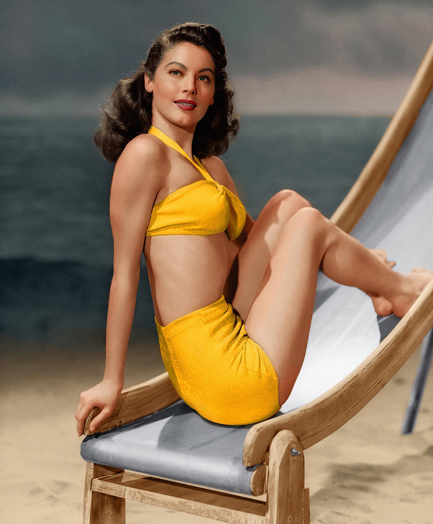 Ava Gardner wearing yellow swimsuit