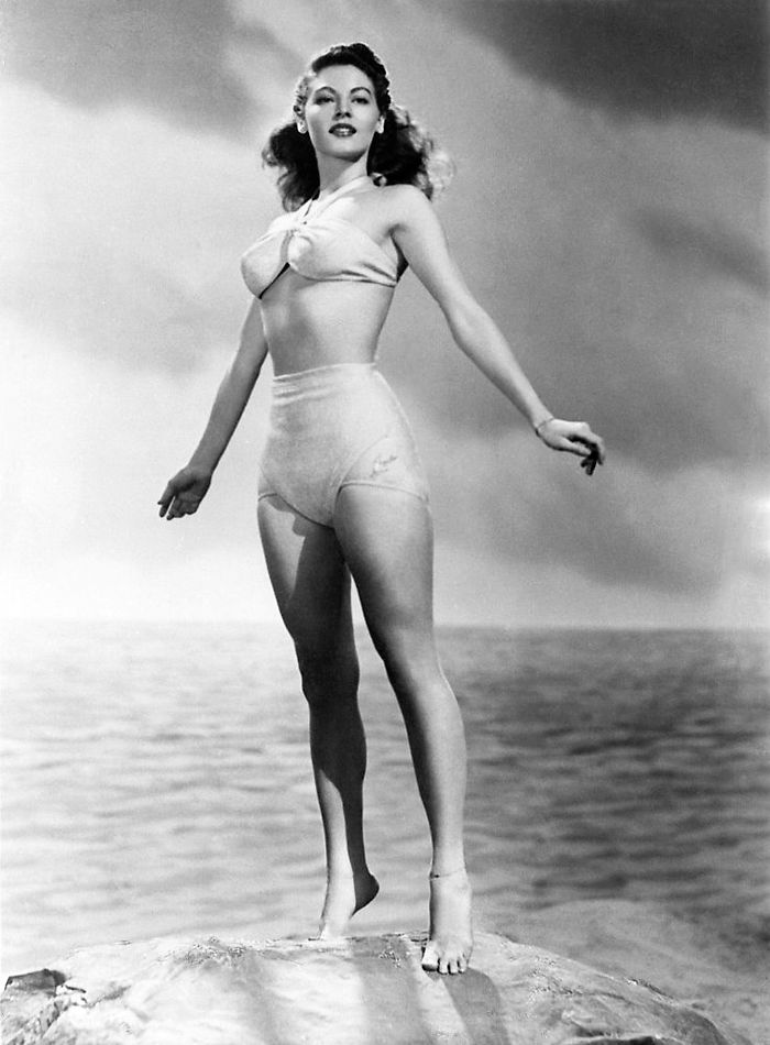 Ava Gardner standing on a stone