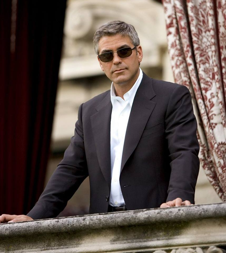 George Clooney looks total clad in white shirt and black suit