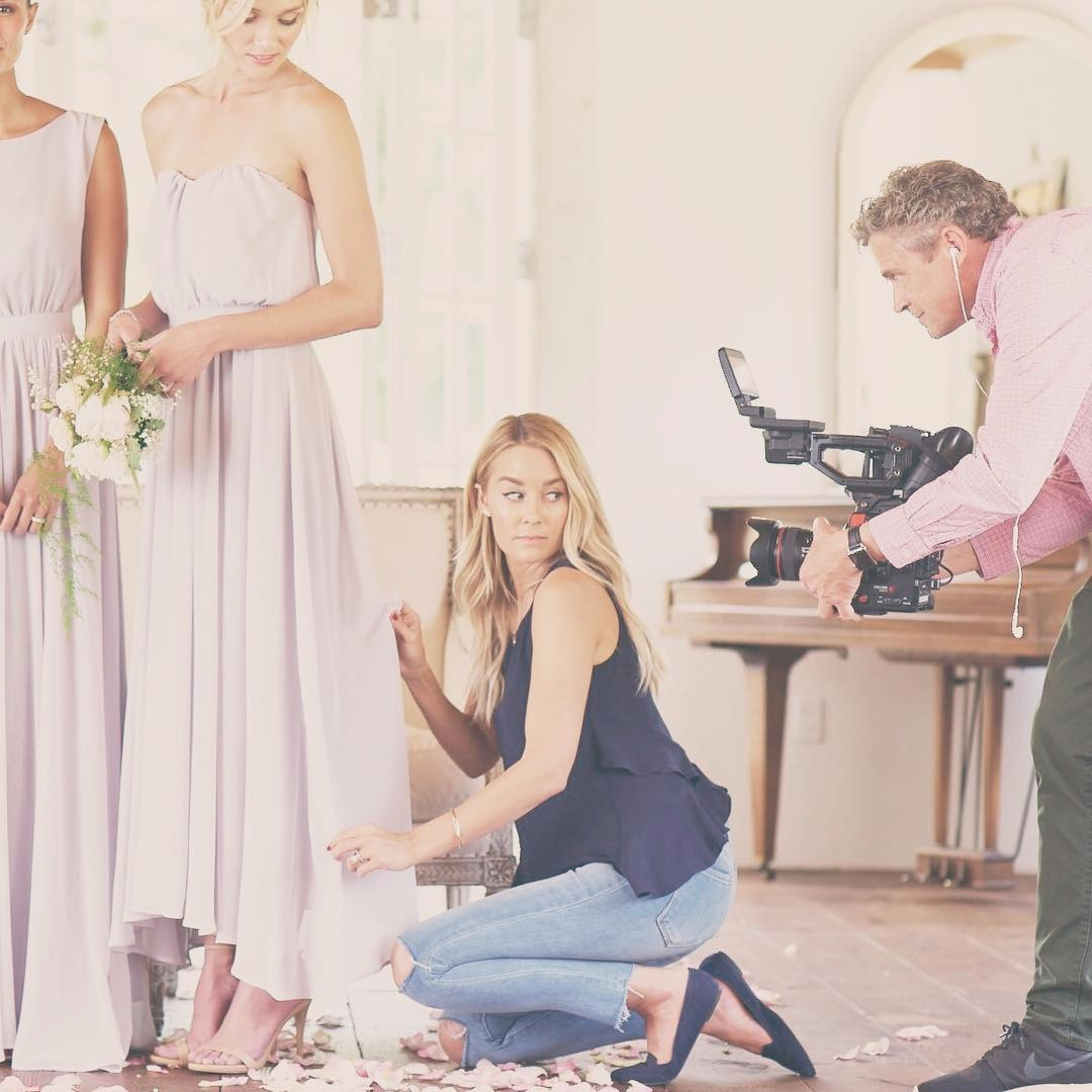 Lauren Conrad is being clicked while doing what she does best, putting her style into some bridesmaids gown. She is looking beautiful in her casual dress up.
