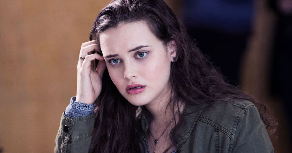 Katherine Langford  is keeping her one hand on her hair