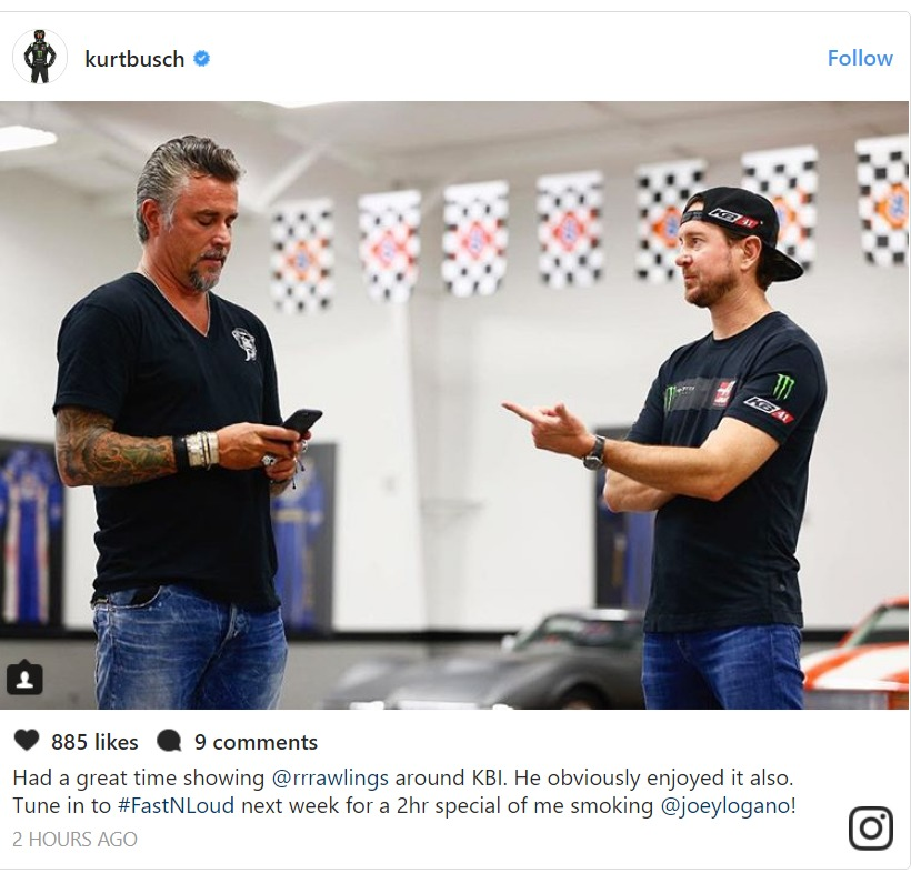 Kurt Busch pointing his finger at Richard Rawlings who is looking at his phone