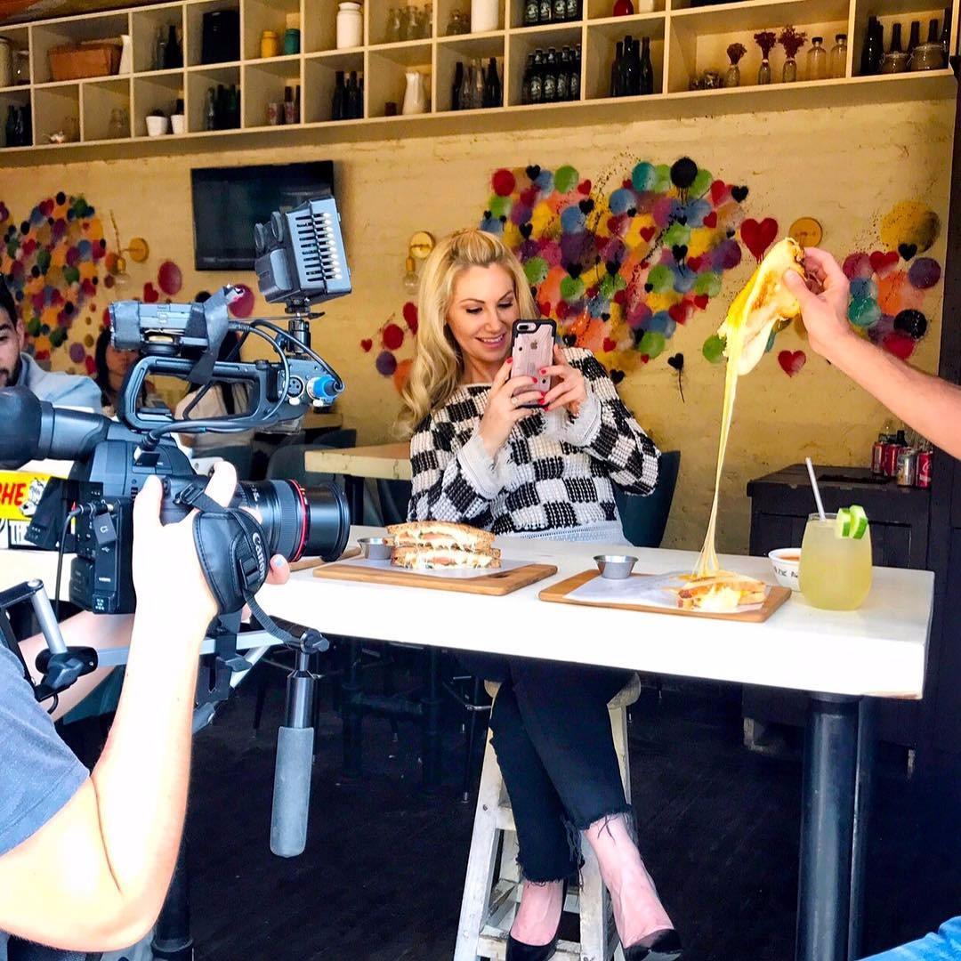 Raina Seitel is clicking the making of cheesy dish in between her shoot at New York Live.
