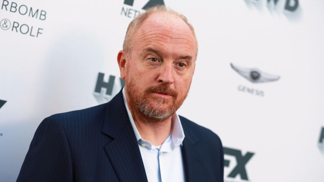 Louis C.K. at an event wearing a suit