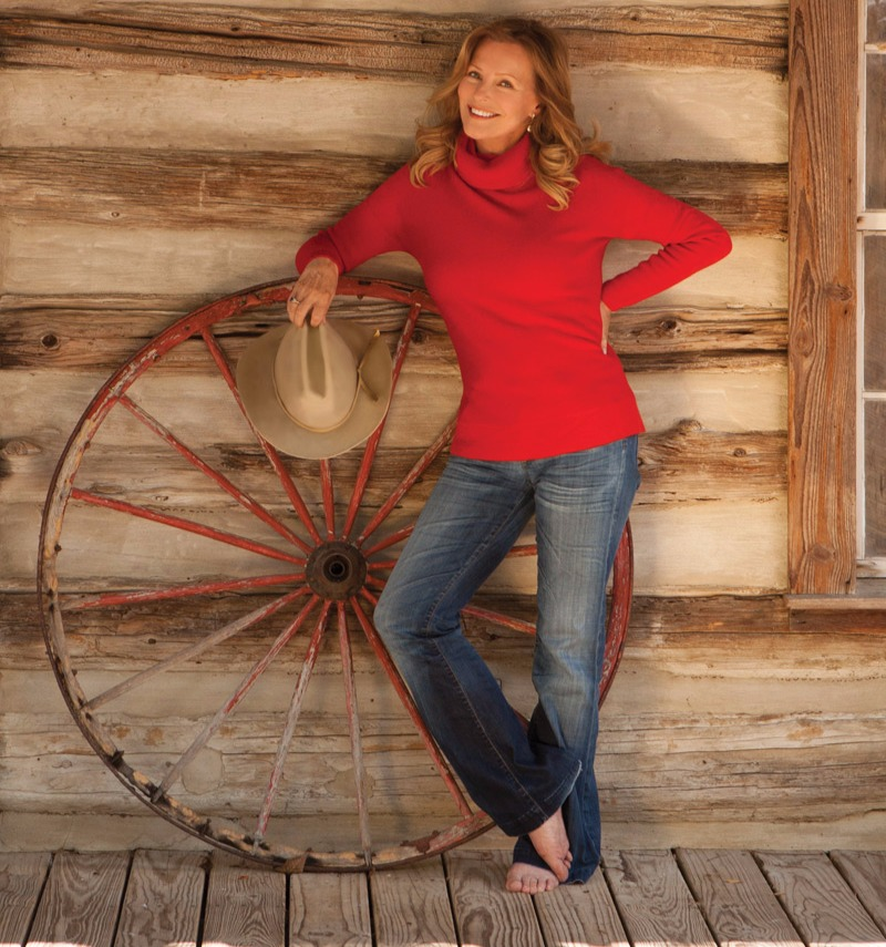 Hot Cheryl Ladd poses for the picture in red sweater and blue jeans