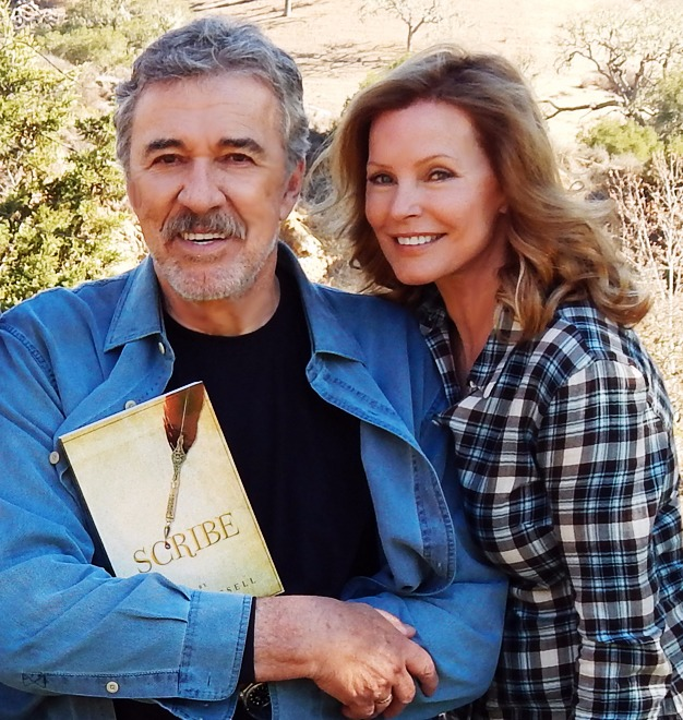 Cheryl Ladd posing for picture with husband Brian Russell as he's seen holding his new novel, 'Scribe'.