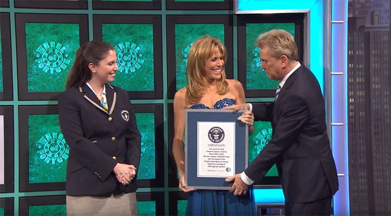 Vanna White and Pat Sajak, co-hosts the famous show Wheel of Fortune.