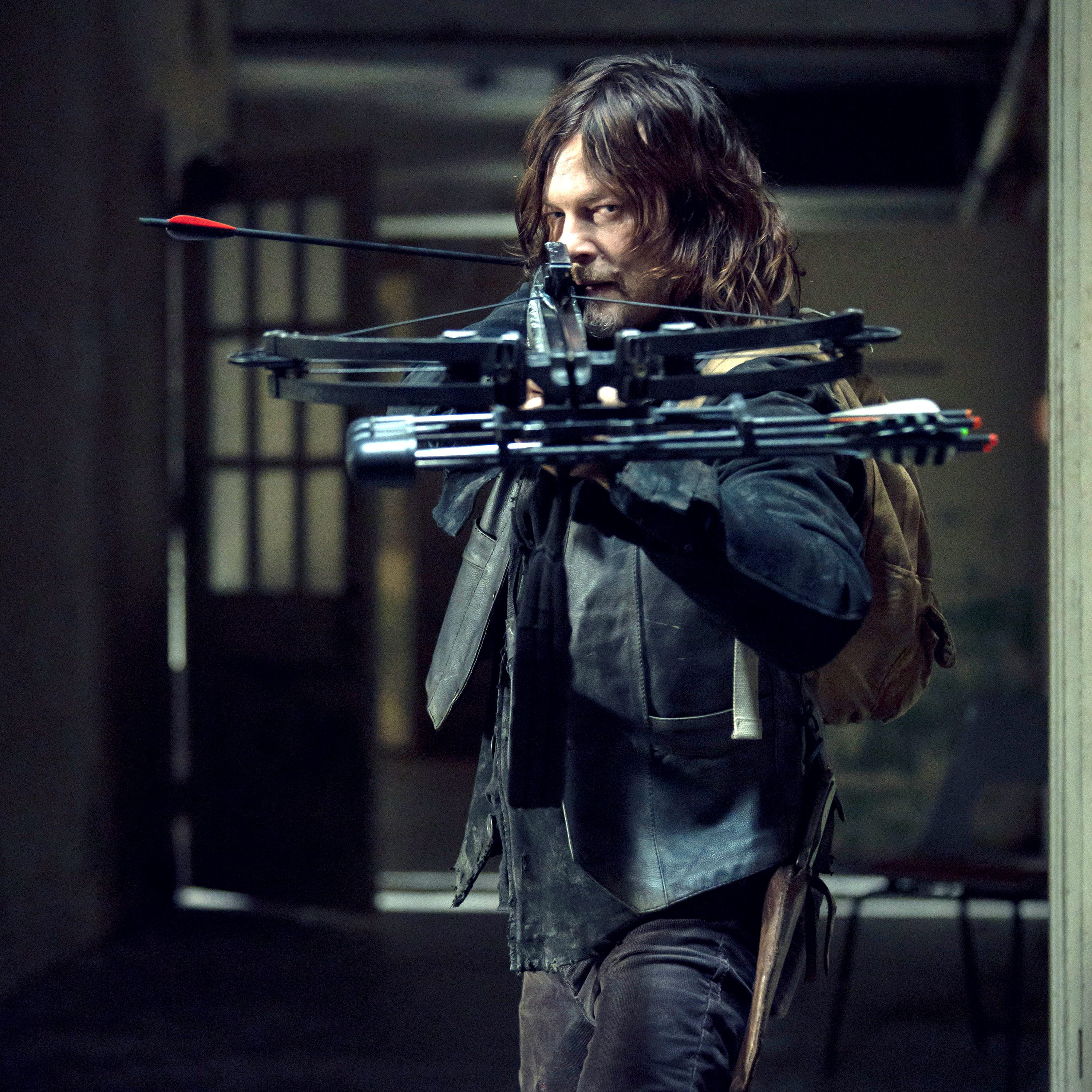 Norman Reedus aiming his archery