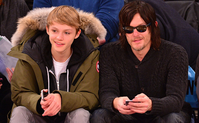 Norman Reedus and his son observing a sport event