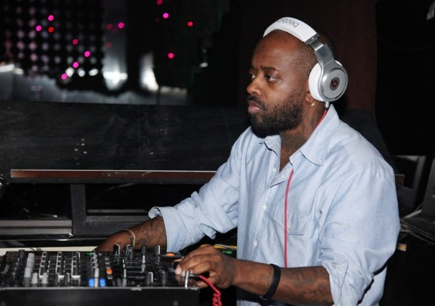 Jermaine Dupri got the Beats headphone on his head and is checking the recording machine. He is the founder of So So Def Productions.