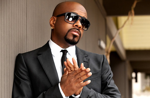 Jermaine Dupri posing in the white shirt and black suit & Tie. He is wearing sunglass. His first act was producing Silk Tymes Leather in 1990.