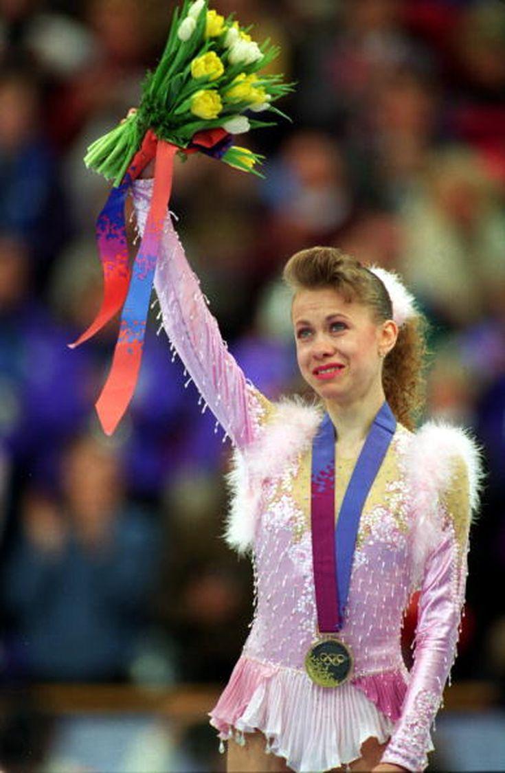 Oksana Baiul celebrates after wining the gold medal in 1994 Winter Olympics