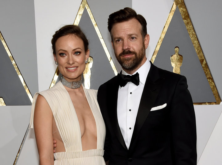 Olivia Wilde and her fiance Jason Sudeikis is standing side by side
