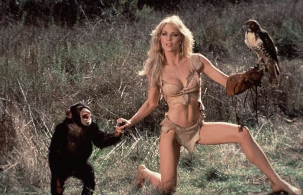 Tanya Robert flaunting her bikini look, holding a monkey on her right hand and a catching bird on left hand. She did photo shoot for movie The Beastmaster