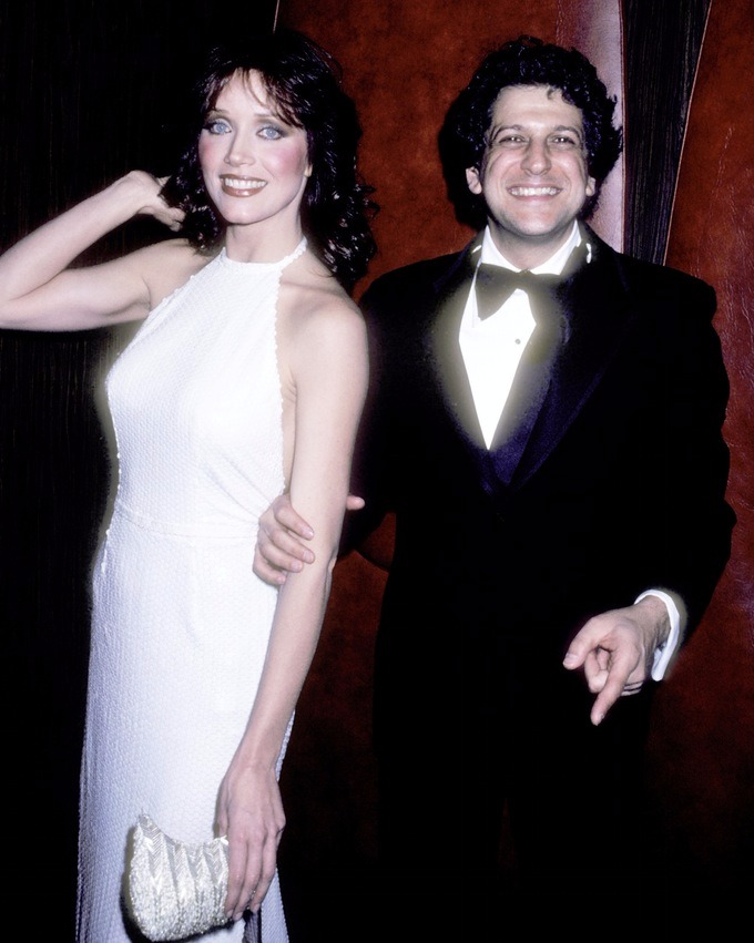 Tanya Roberts, the happy couple sharing a smile as they pose for the camera