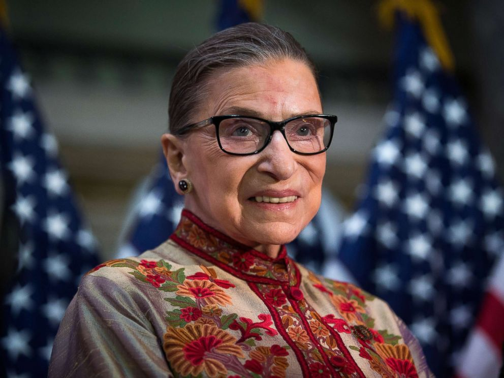 Ruth smiling. She is wearing glasses.