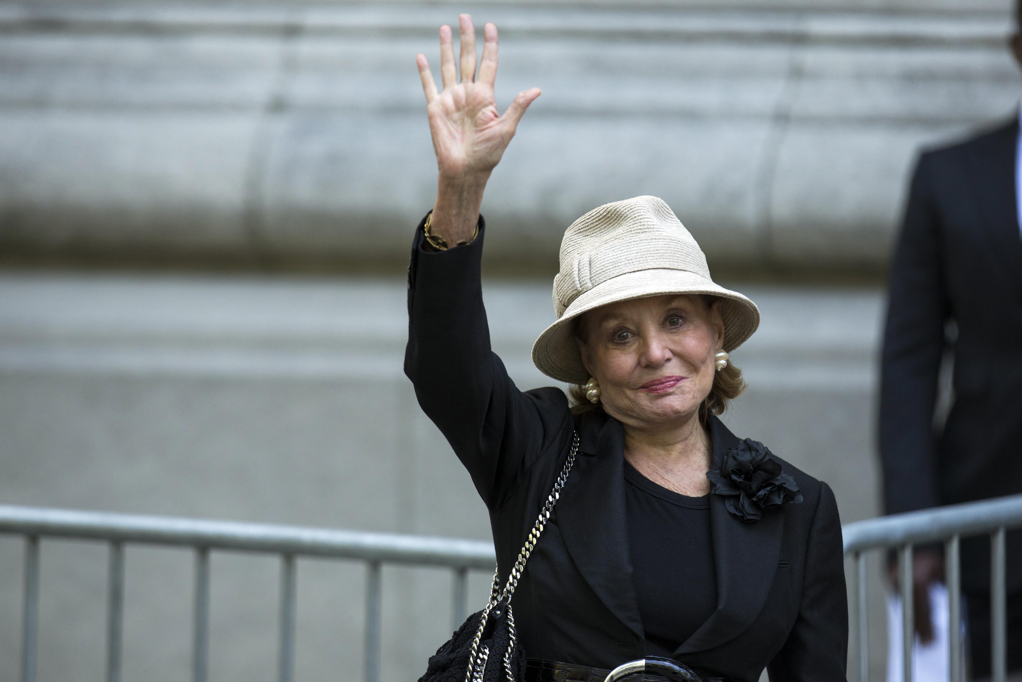 Barbara Walters waving her hand