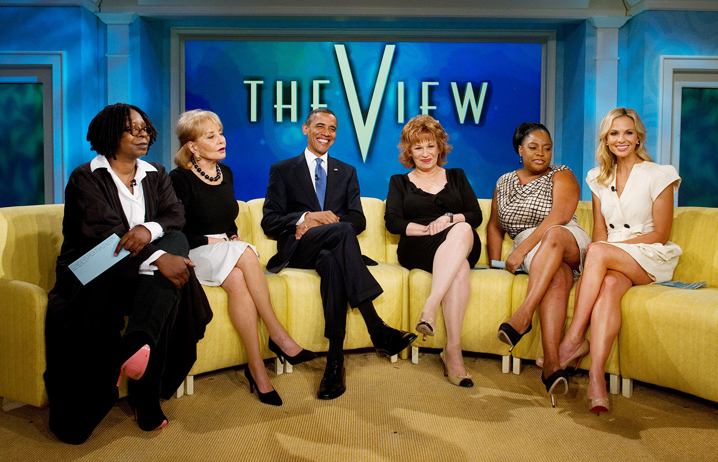 Barbara Walters in the show The View with Barack Obama and others