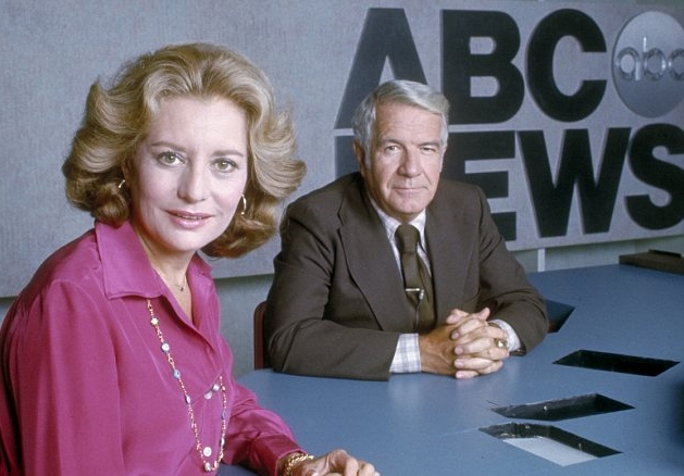 Journalist Barbara Walters in her blonde hair and Harry Reasoner staring at the camera.