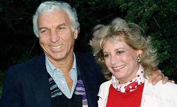 Renowned journalist Barbara Walters ex-late-husband Merv Adelson embracing her.