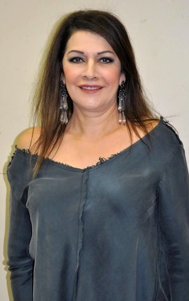 Marina Sirtis looks stunning in the off-shoulder dress