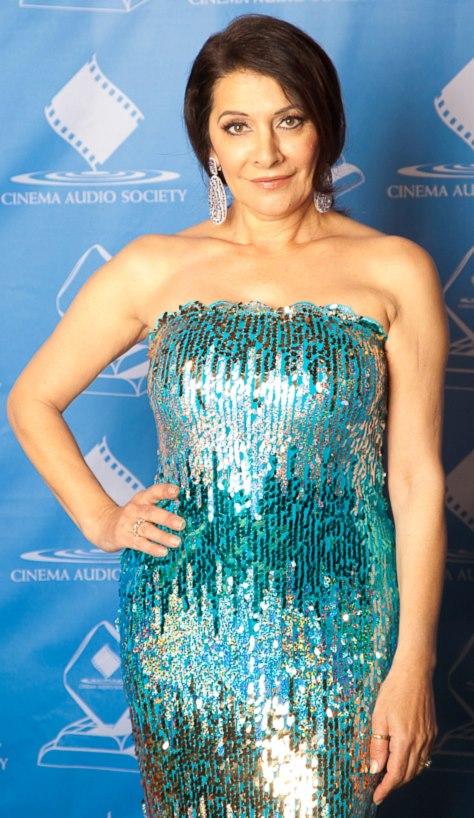 Marina Sirtis wearing a glittery sky blue dress