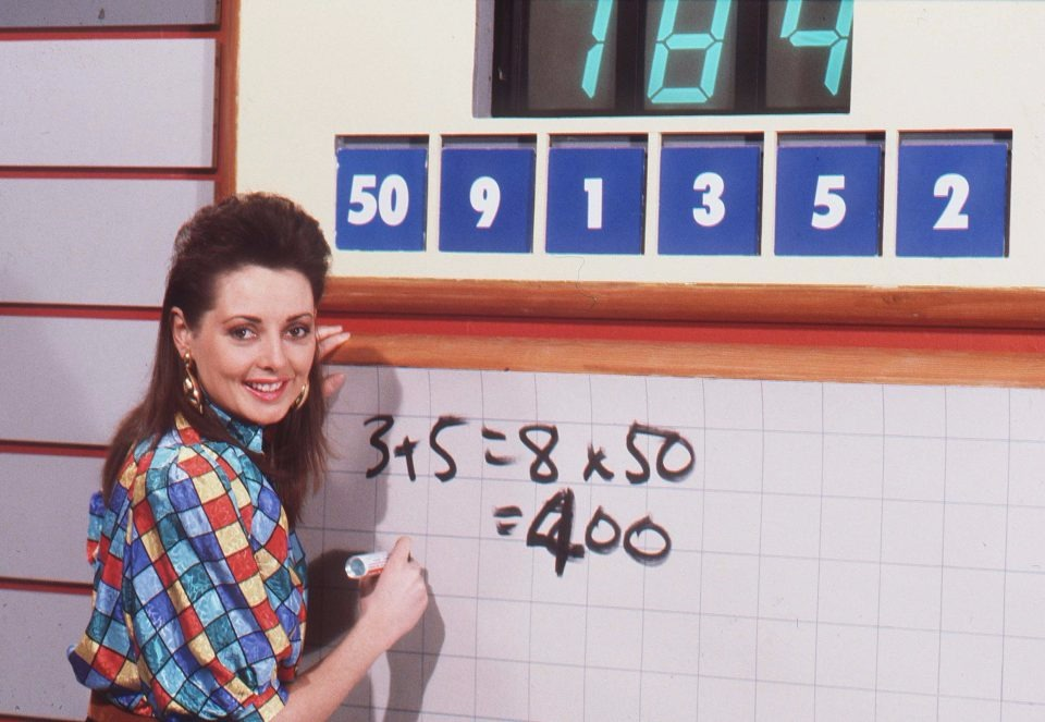 Carol Vorderman in her young days pose on the set of the show Countdown