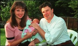 Carol Vorderman and Patrick King holding one of their babies