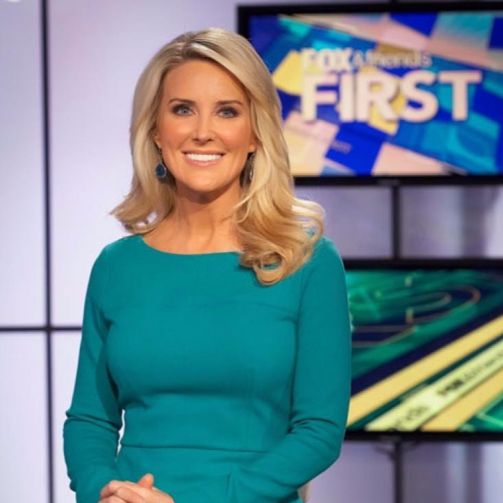 Heather Childers on the set of Fox & Friends First wearing a turquoise colored dress