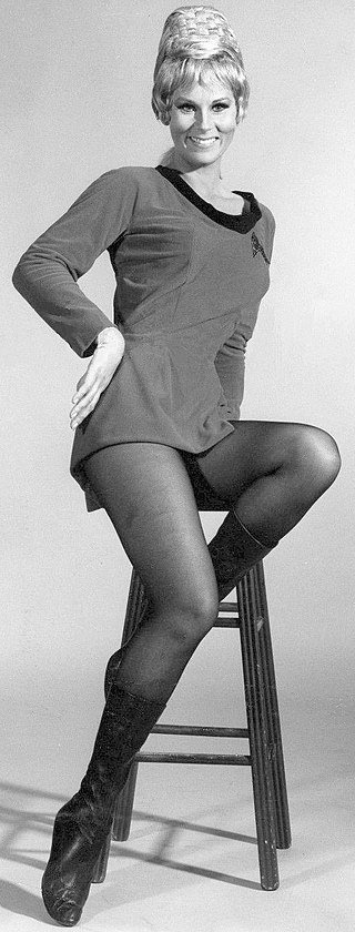 Grace Lee Whitney sitting on a chair