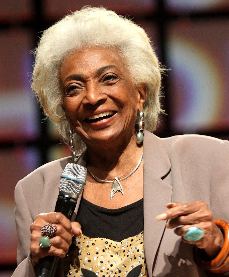 Nichelle Nichols saying something in the mic
