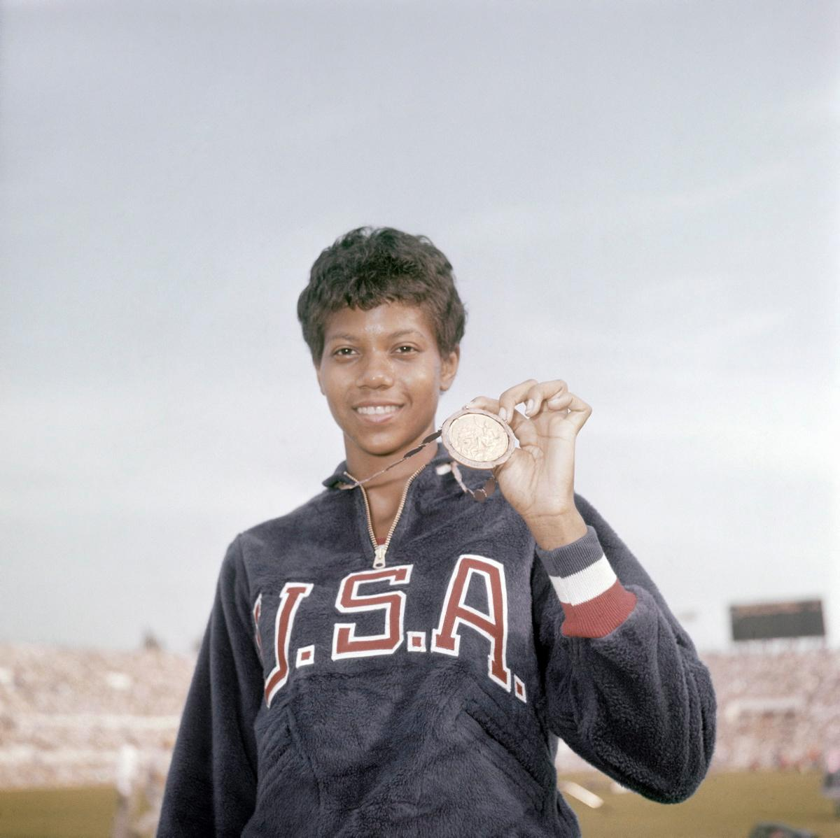 Wilma Rudolph shows off her bronze medal in the Summer Olympics 1956