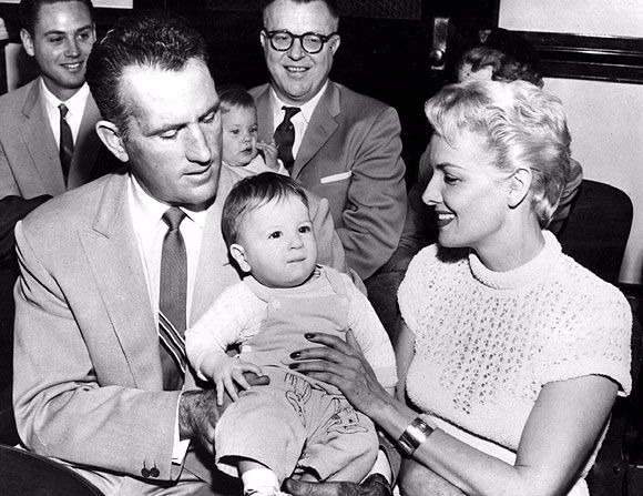 Jane Russell and husband Bob Waterfield carrying their adopted son