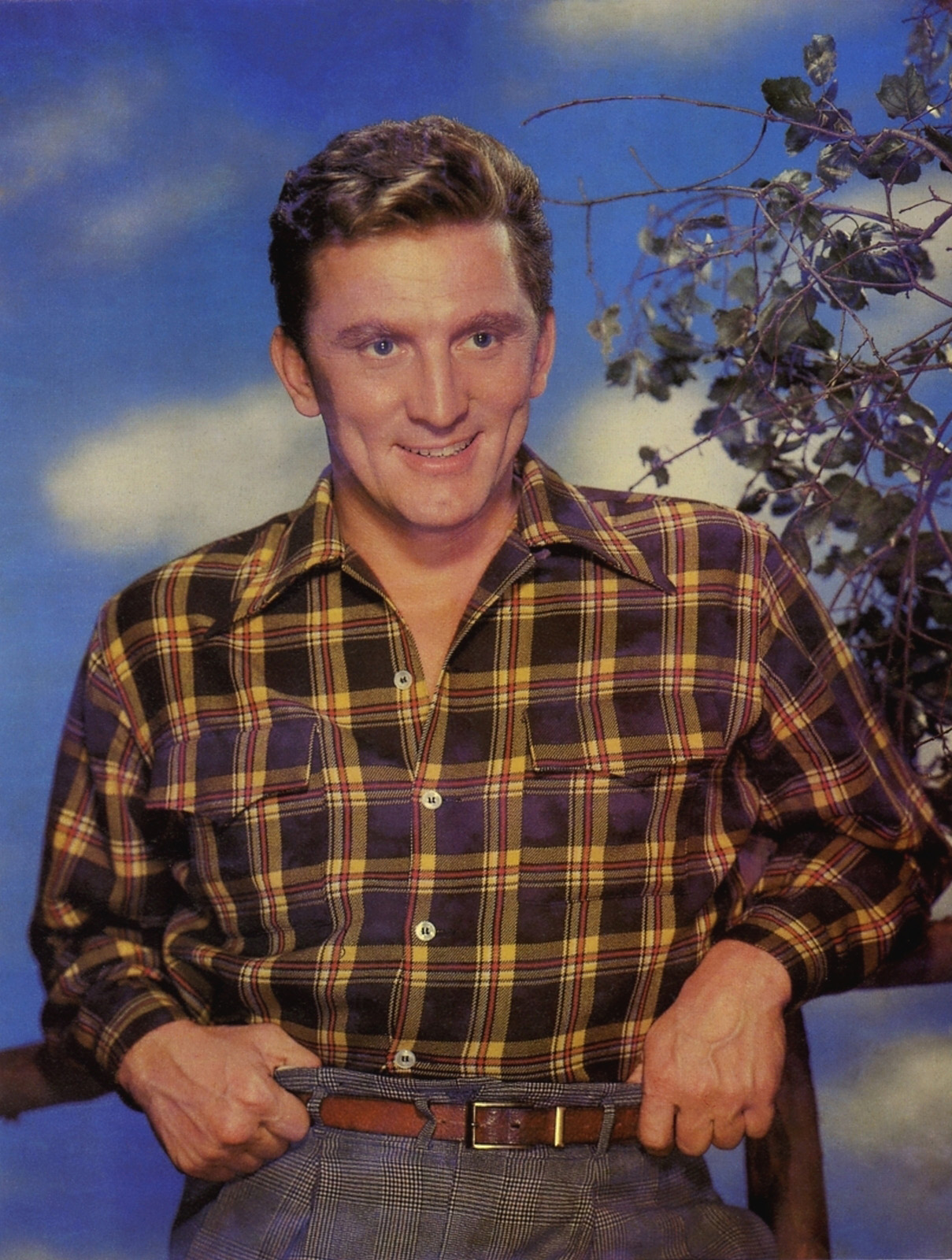 Young Kirk Douglas wearing check shirt and a smile on his face