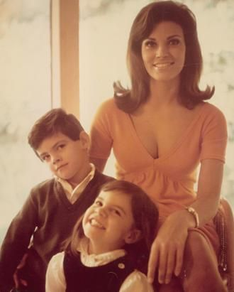 Raquel and her children smile for the camera. The picture was taken in mid 1960s