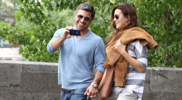 Cote de Pablo is holding Diego Serrano's hand and Diego is found capturing moments from his mobile phone.