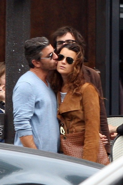 Diego Serrano is kissing Cote de Pablo in her cheeks.