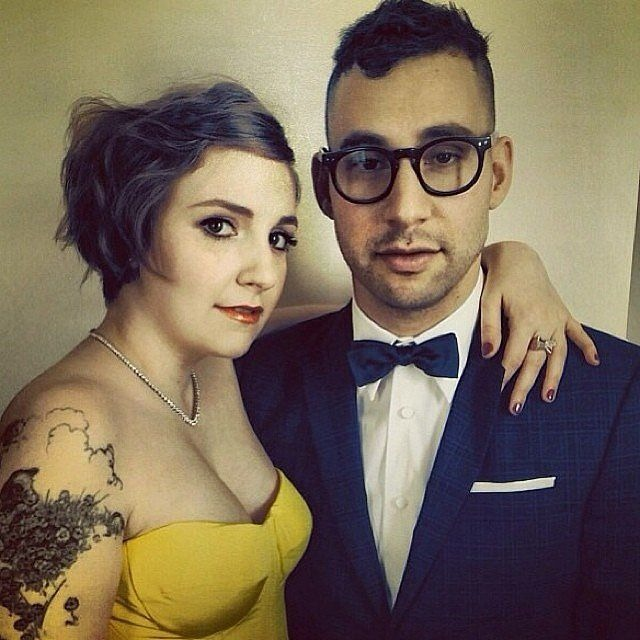 Lena Dunham and Jack Antonoff ready for the Golden Globes. Lena has her hand wrapped around Jack. She is wearing a yellow tubeless dress showing off her tattoo. Jack is dressed all gentleman.