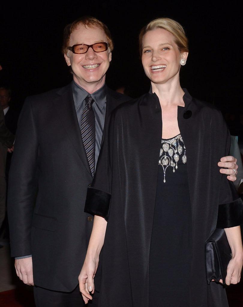Bridget Fonda and her husband Danny Elfman seen together smiling at the camera.