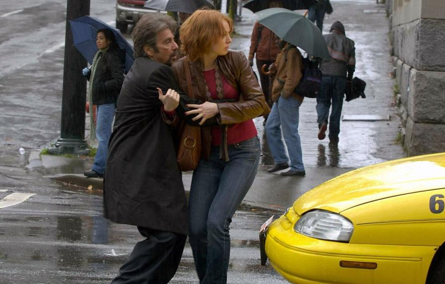Al Pacino holding Alicia Witt from the back and Alicia Witt holds Al's hand as they shoot a scene .