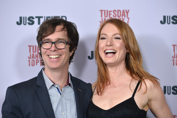 Alicia Witt is standing close to Ben Folds as they smile for a picture.