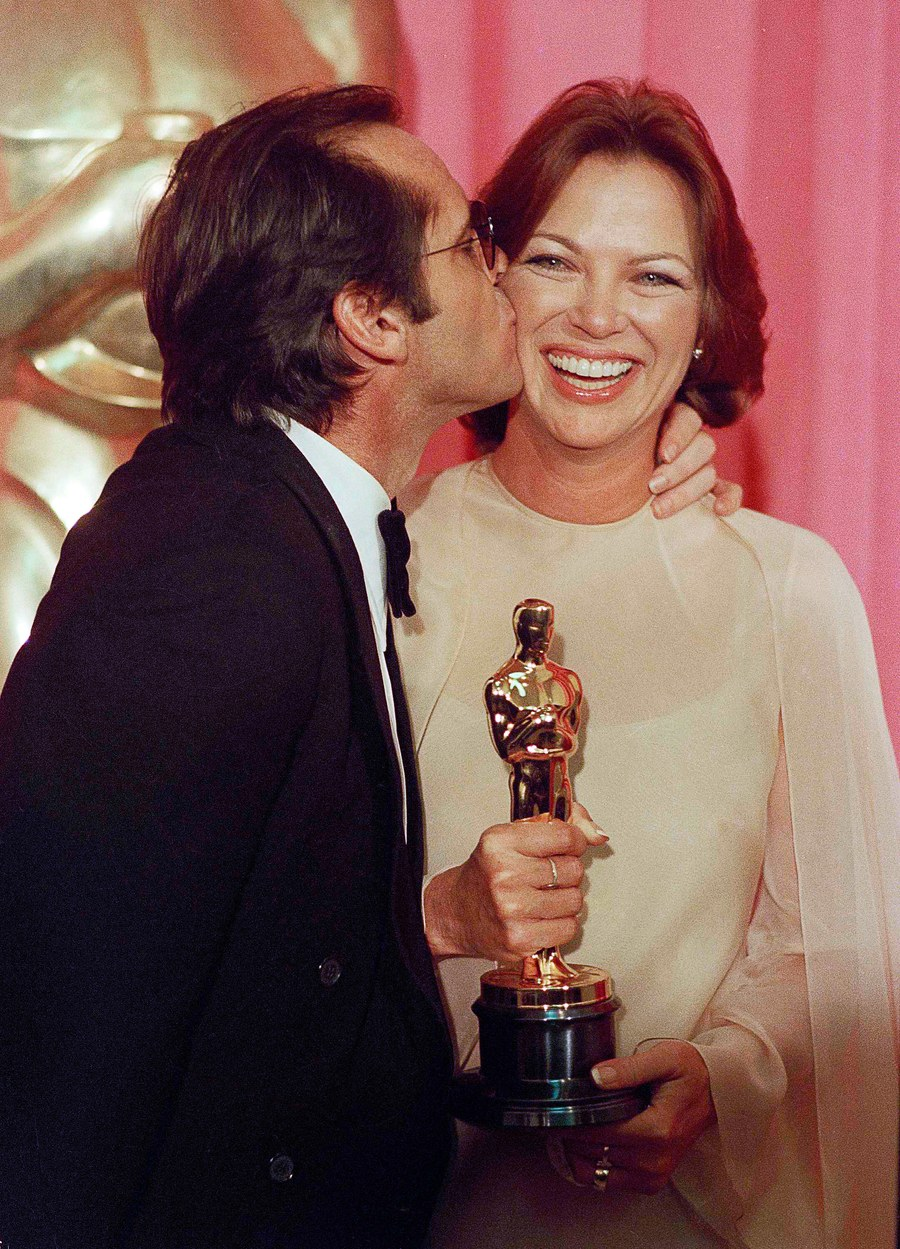 Louise Fletcher being kissed after winning the Academy awards