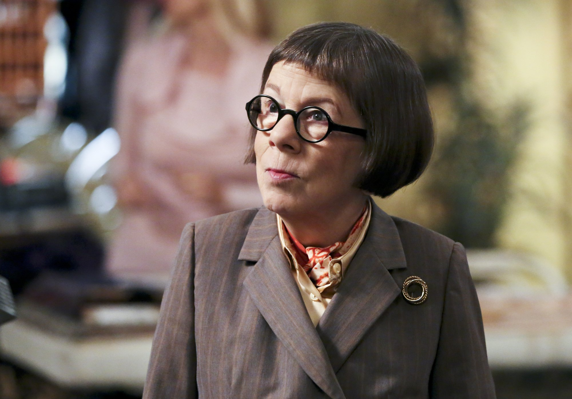 Linda Hunt wearing a suit
