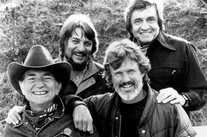 Willie Nelson, Johnny Cash, Kris Kristoffersson and Waylon Jennings appear in a black and white photo for The Highwaymen