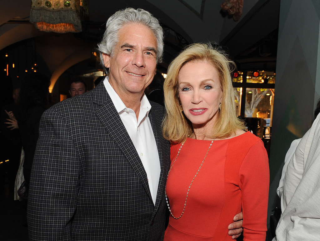 Donna Mills and Larry Gilman in a happy mood in a event