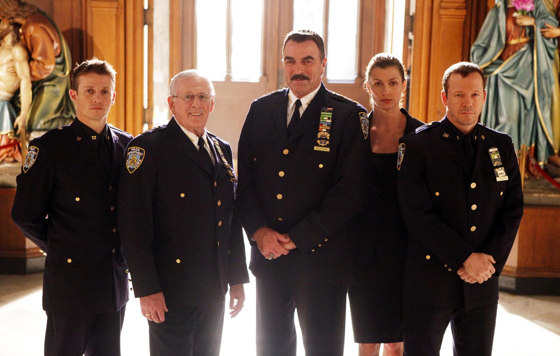 Donnie Bridget Will Len Tom in a photo shoot wearing police uniform