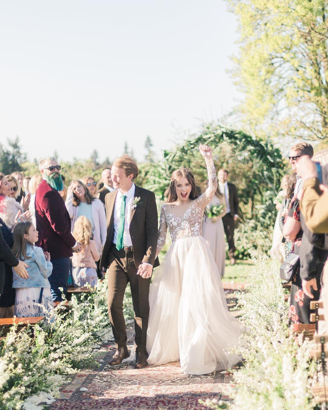 Acacia Brinley and her husband, Jairus Kersey walking down the aisle